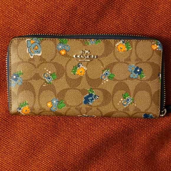 Coach Handbags - Coach floral blue trim wallet